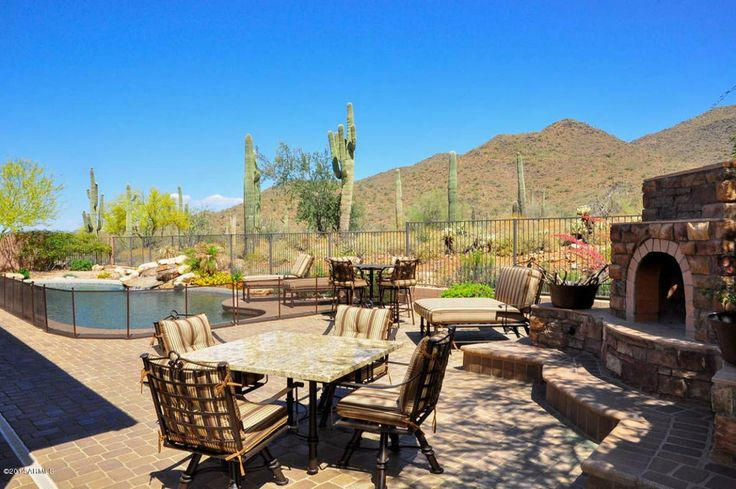 Southwestern Patio with Fence, outdoor pizza oven, exterior tile floors