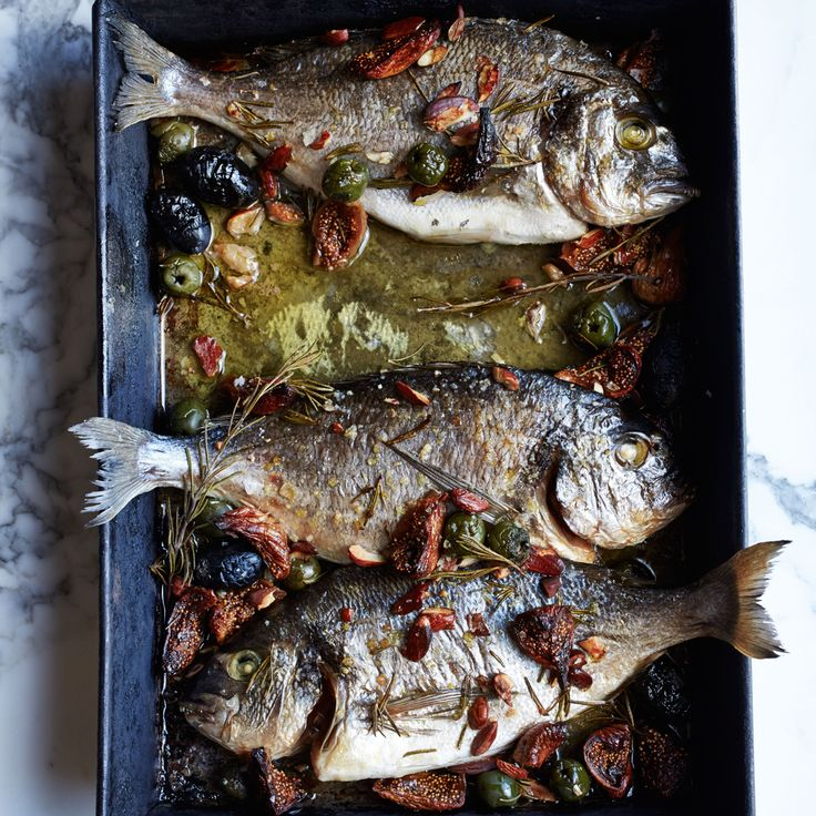 Roast Dorade with Figs, Olives and Almonds - Make sure to use moist figs so they don't dry out during baking. http://www.foodandwine.com/recipes/roast-dorade-figs-olives-and-almonds