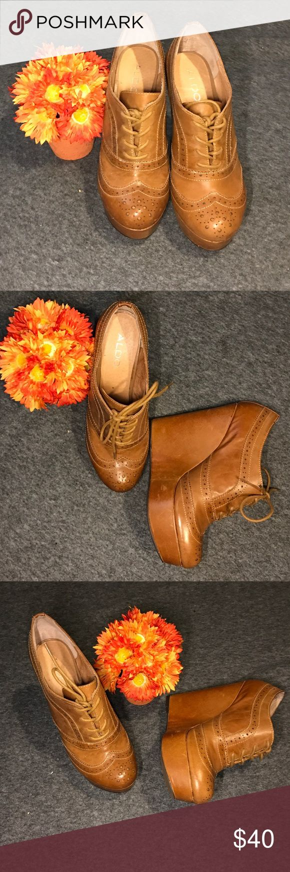 👠ALDO LADIES WEDGE SHOE👠 👠ALDO LADIES WEDGE SHOE👠 Great Classy shoes, Leather, New with box, A girl can always walk in a wedge hill🤣 Tan Color can be worn with almost anything, very comfortable, 5in heel, 2 1/2 in platform, awesome shoes💥 Aldo Shoes Wedges