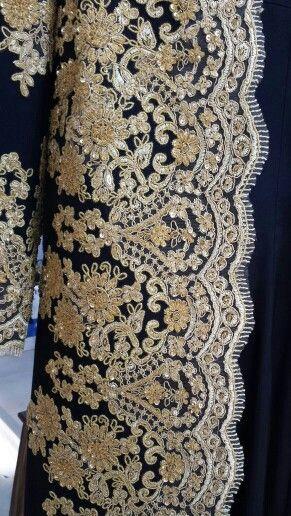 Gold on black Long coat.