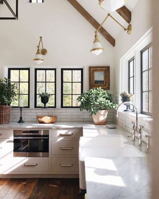 white open kitchen with lots of windows and green plants dark wood rh pinterest com