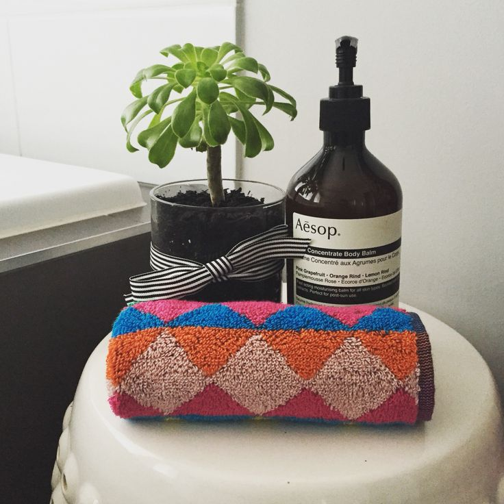 Pretty way to reuse a Glasshouse Fragrance Candle jar! Glasshousecandle #succulent #glassjar #bathroom #interiors