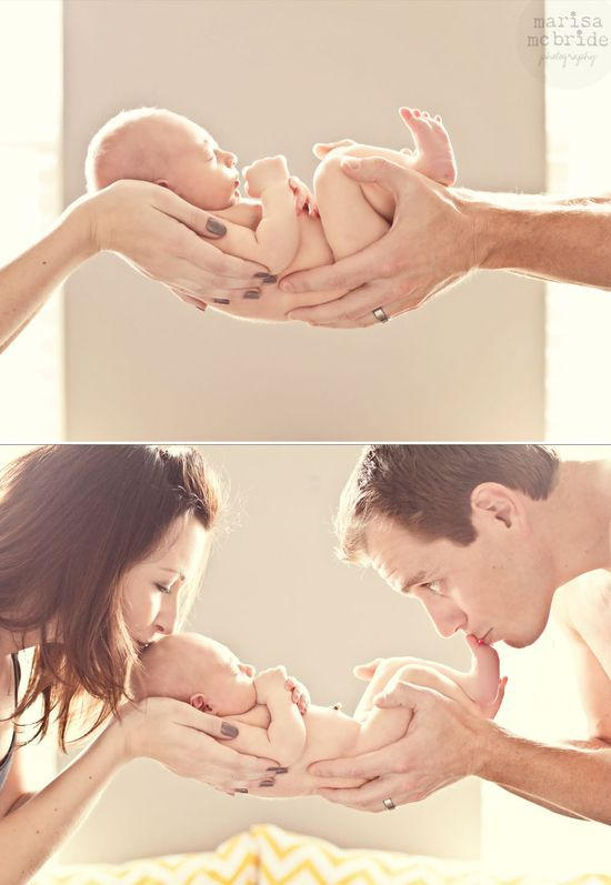 Cute newborn shot with mom and dad