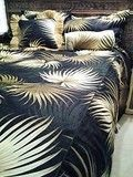 Shown is a king size duvet  cover on A full size bed, so it looks more like a bedspread, and it looks perfect  with the tommy bahama style head board. Added to the look is our Raffia pillow in Island retreat black  and a Bolster pillow in Island Retreat Natural, both are available separately.
