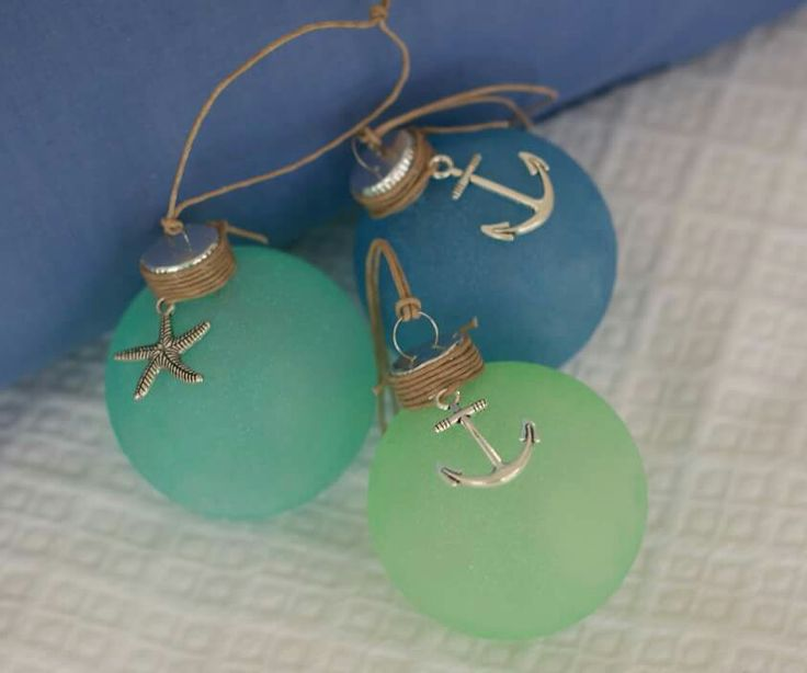 Coastal Christmas ornaments - so simple with the sea glass colors and nautical charms.