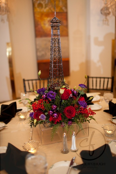 Paris event at The Mayflower Hotel jewel-tone floral centerpiece with Eiffel Tower | bergeronsflowers.com