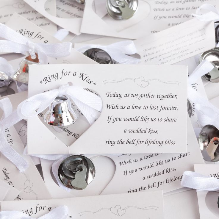 "Ring-for-a-Kiss Favor Cards   Each metal bell comes with a card that states: ""Today, as we gather together, wish us a love to last forever!"