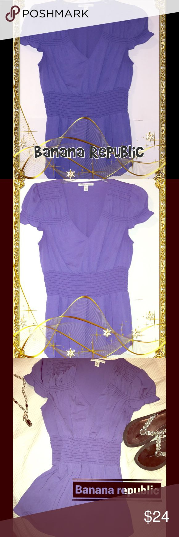 Banana republic V-neck elastic waist slimming top This purple V-neck 100 percent polyester purple women's top is adorable one – it looks really cute with a pair of jeans. Very slimming due to the elastic waistband. Preowned pre-loved – great color must have for spring and summer – no trades, low balls no response. Please like to save. Selling as is – super cute Banana Republic Tops Tank Tops