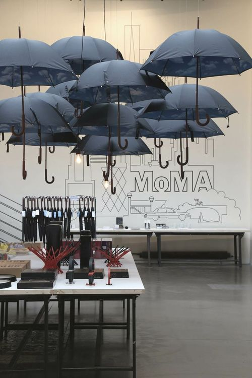 :: Havens South Designs :: loves Moma event styling. These umbrellas are enchanting hung with pendant bulbs.