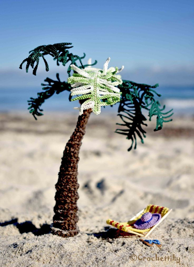 """Take a piece of Aussie beach with you!  Miniature """"Dolce vita"""" Yarn: 100% mercer cotton, chenille.  Fill: non-allergenic, polyester fiberfill.  Size: palm is approx 19 cm high, flip-flops are approx 1 cm long.  Wire frame for palm. Wooden frame for beach chair. Wooden stand with natural sand. $96  Shipping is available. Please contact Natali at crochettiky@gmail.com or visit http://crochettiky.com if you have any queries or would like a work commissioned."""