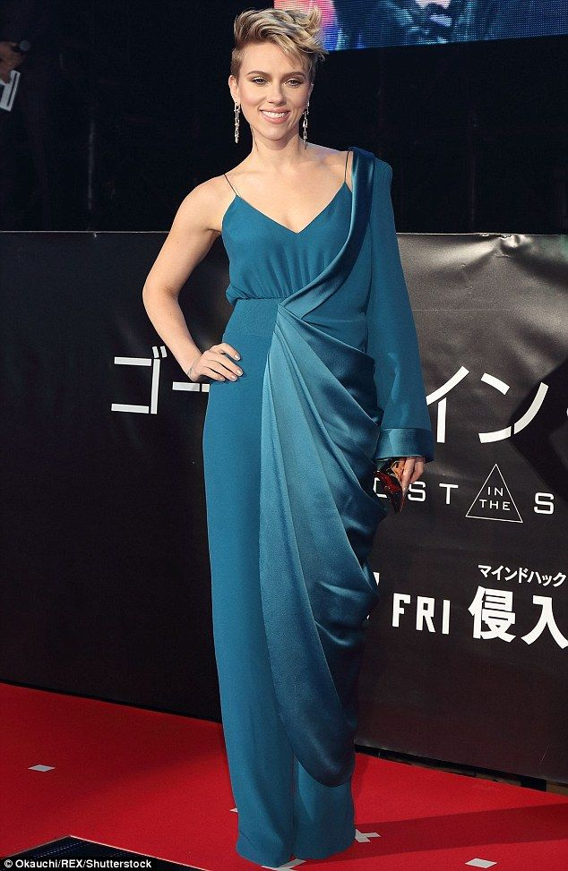 She pulled it off! Scarlett Johansson looked sensational in this complicated teal dress at the Ghost In The Shell premiere in Japan on Wednesday evening