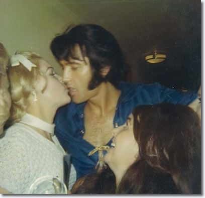 Elvis Presley! Mickie M. Malbrough being kissed by Elvis, after she thanked him for the photo(s) This photo was taken in Mobile, Alabama the last night of Elvis' come back tour in September 1970. -