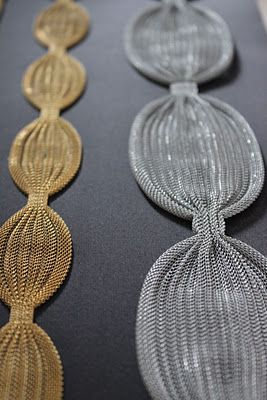 metal trim. These would be pretty curtain tie-backs.....INTERESTING IDEA....AS TIEBACKS THESE WOULD LOOK GOOD WITH HOLLYWOOD GLAM,CONTEMPORARY,MODERN AND TRANSITIONAL  DECOR,MAYBE EVEN FOR AN URBAN LOFT...CHERIE
