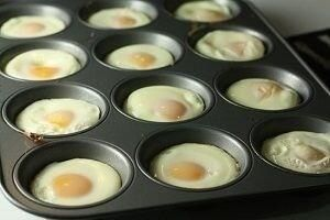 This is a great idea for perfect breakfast sandwich-sized eggs. -Lightly grease a muffin tin. -Add as many eggs as you need. -Place in a 350-degree oven for 15-20 minutes. -Put on an English Muffin for a great breakfast sandwich on the go!