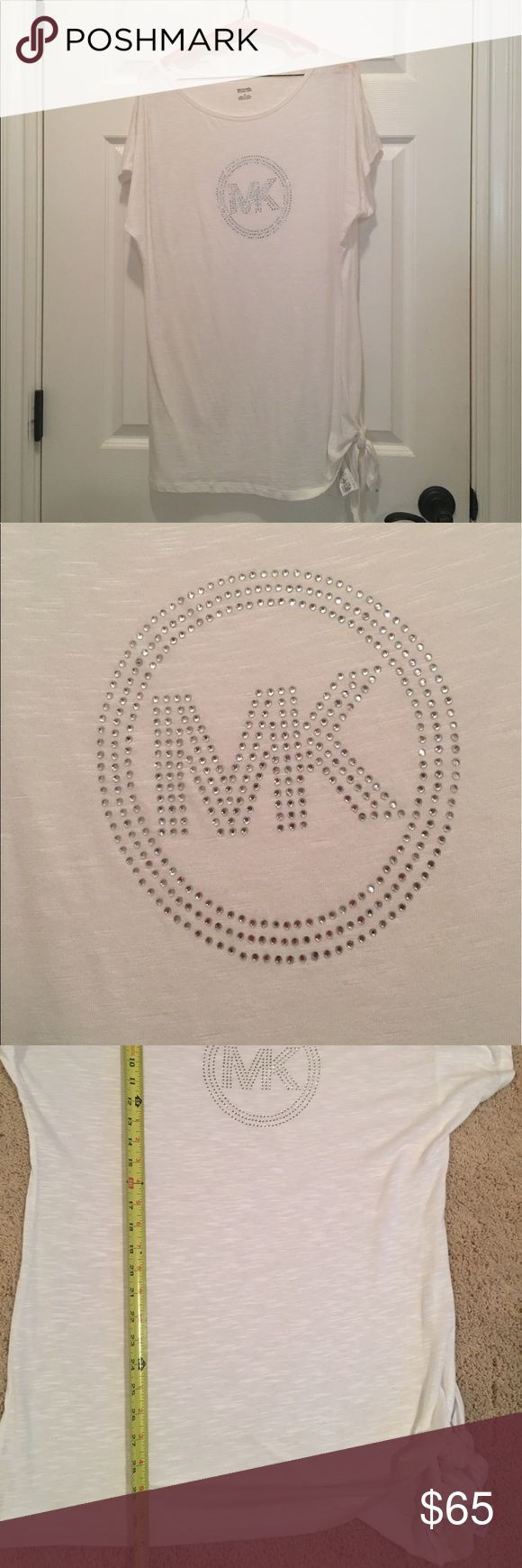 Michael Kors rhinestone t shirt white medium Michael Kors medium white cover up or t shirt. This would be fabulous with leggings or a cover up at the pool. 31 inches long with a cute tie knot at the side. 21 inches from under arm to arm. The Rhinestone MK is 6 inches side to side. MICHAEL Michael Kors Tops Tees - Short Sleeve