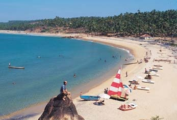 A beach town, an evergreen, dreamy place, Kovalam's high rock promontory and calm bay of blue waters make this beach paradise a heaven for tourists from all over the world. #CoxandKings