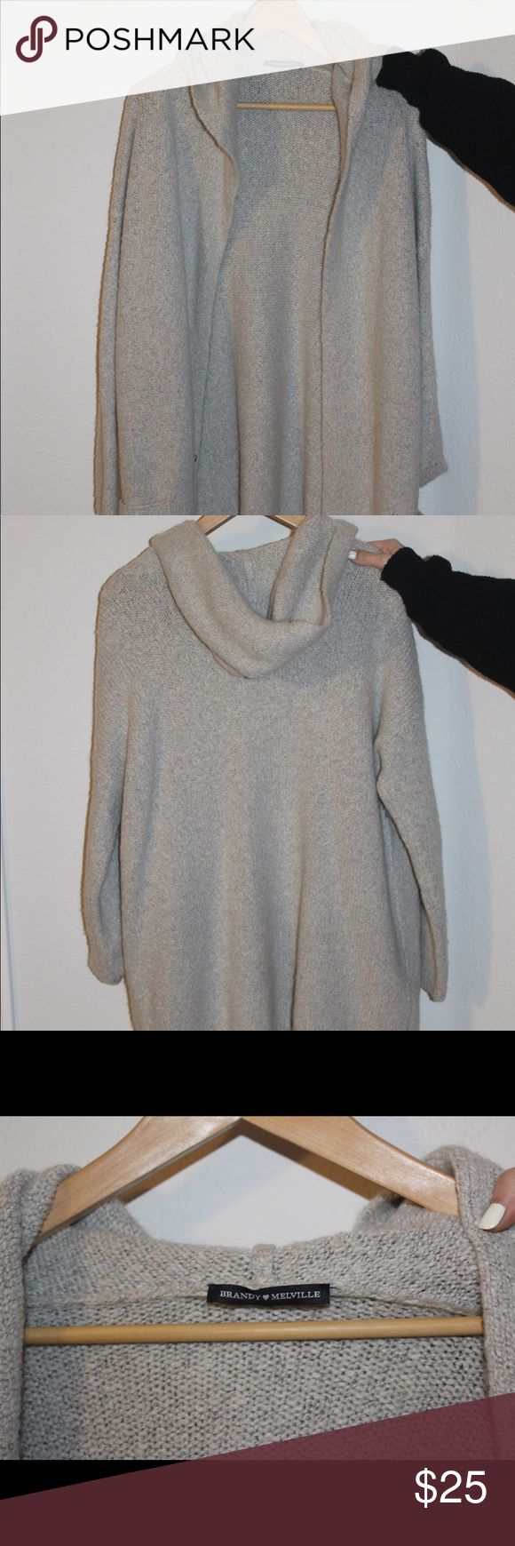 Light gray Brandy Melville cardigan It's a long, thick, light gray cardigan with two front pockets!! so cozy and great for layering!! Brandy Melville Jackets & Coats Trench Coats