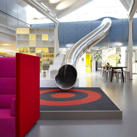 Via Miss Design Says  Forget the stairs … at Lego's headquarters in Billund designed by Rosan Bosch and Rune Fjord you can whiz away from the meeting rooms down a metal slide.