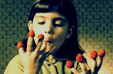 (Amelie) I love Jean-Pierre Jeunet's work... oh to be a child again with a strawberry on each finger. yum.