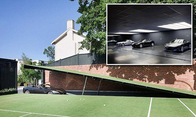 A modern day Batcave sits six metres below ground in Melbourne mansion #DailyMail