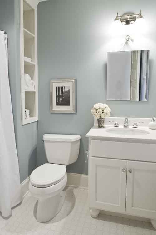 Duck egg blue bathroom with linen shelves