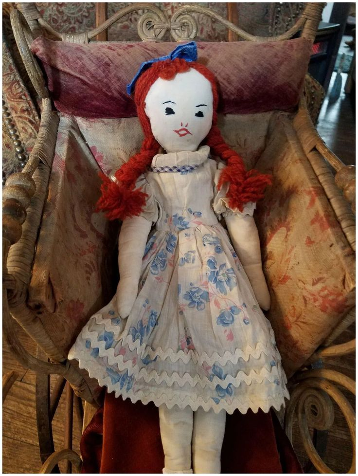 16 Vintage 1930's Homemade Cloth Doll. Happy girl with red wool yarn braids. She has nicely stitched eyes and mouth. Her red wool yarn braids are sewn to her head. She is made of a fine white cotton