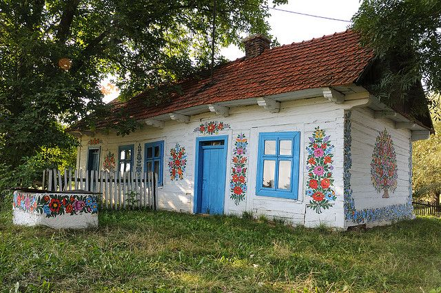 Zalipies is a small village in the Malopolska region of Southern Poland. There is a tradition that cottage, barns, fences and wells are painted with beautiful murals of flowers, animals and other coloured motifs. Once a year a competition is held to judge the most beautiful.