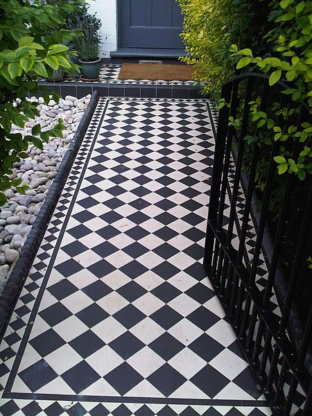 The dream tiles path for the front garden. Additional bay trees either side of the door would be wonderful!
