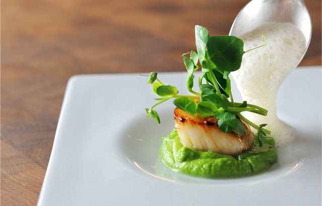 Pan-fried scallops with peas and cumin foam by chef Chris Horridge.