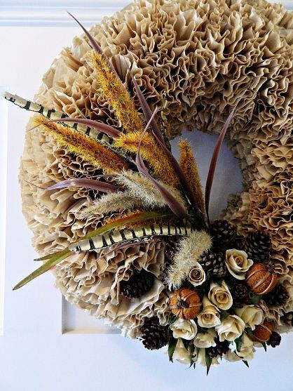 Fall Wreath made with coffee filters.  Love the feathers.
