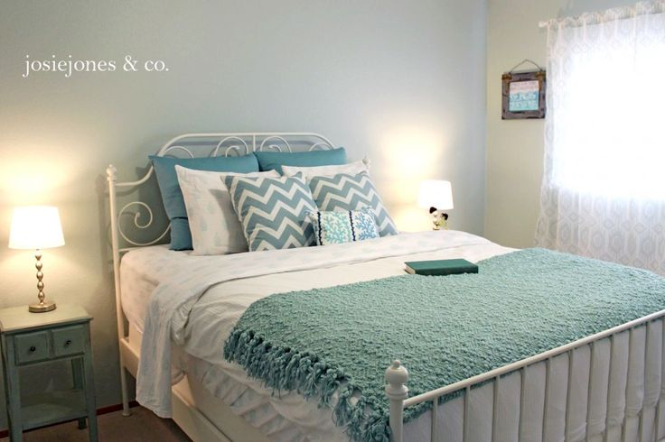 duck egg blue bedding with brown painting all the wall bedroom ideas