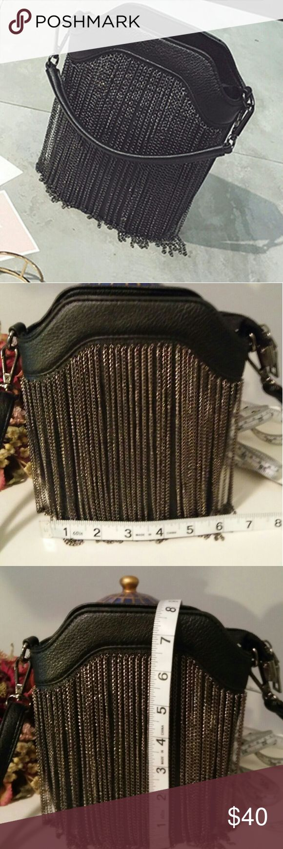 🔥 2×HP 🔥THE MELISSA SMALL BUCKET CHAIN BAG THE MELISSA SMALL BUCKET CHAIN BAG STRUCTURED PU LEATHER SOLID BACK HEMATITE CHAIN DETAIL IN FRONT COMES WITH A HAND STRAP AND A CROSSBODY STRAP WITH A DROP OF A LITTLE OVER 21 INCHES A LITTLE OVER 6 INCHES LONG BY 7 INCHES HIGH GREAT WHEN YOU WANT TO GIVE THAT OUTFIT A LITTLE EDGE PRICE FIRM UNLESS BUNDLED SORRY NO TRADES Bags Mini Bags