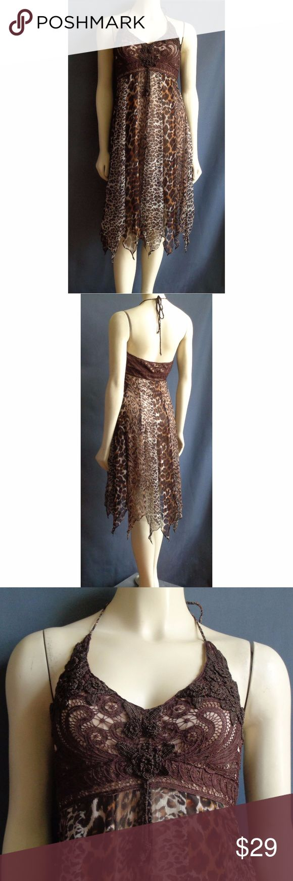 Sue Wong Leopard Spot Crochet Asymmetric Dress 10 Sue Wong leopard spot silk halter dress in a size 10. Side zipper closure. Handkerchief asymmetrical hem. Braided silk ties is tied around neck. Crochet lace at bust. Fully lined. Soft padding at bust.  80% silk & 20% rayon. Spot clean only.  Measurements Taken Laid flat:  18 inches across underarm to underarm   15 1/2 inches across waist  20 inches across hips  42 inches long from top of shoulder to hem at longest point Sue Wong Dresses…