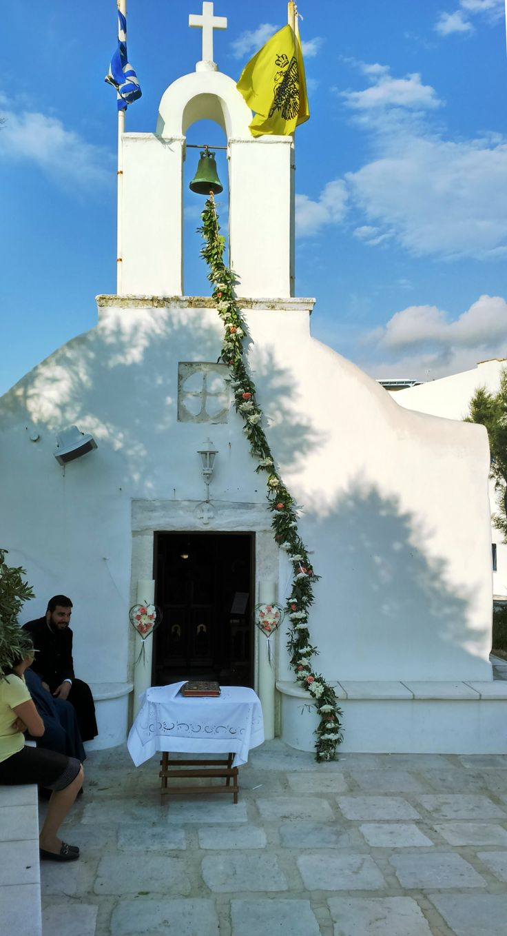 Bell rope flowers with heart lambadas - candles for a beautiful white church in Greece - by the sea - St. George Beach Naxos