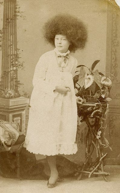 """Circassian Beauty    In the 1860s, P.T. Barnum exhibited women whom he claimed were Circassian beauties. They wore a distinctive Afro hair style and were known as """"moss haired girls."""""""