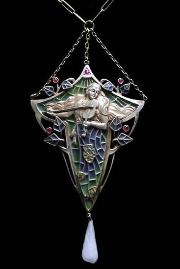 TERPSICHORE', ART NOUVEAU PENDANT A gilded silver, plique-a-jour and enamel pendant with a pearl drop. This Art Nouveau pendant depicts the Muse of Music and Dance holding a violin rather than the traditional lyre. German. Pforzheim c.1900.