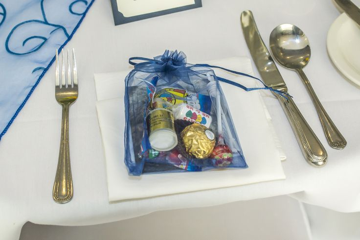 Navy blue bag filled with sweets and bubbles as a way of saying Thank You.