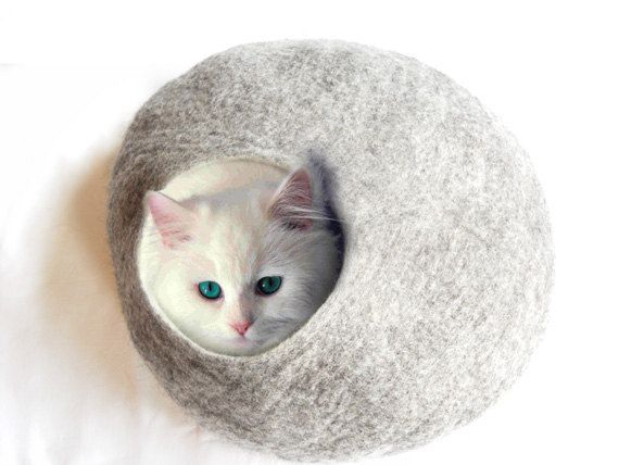 Like my cat would ever use this haha! I want a me-sized one! It looks so cozy!    Cat Bed Cat Cave Cat House Natural Grey Felted - Free Cat Ball. £36.50, via Etsy.