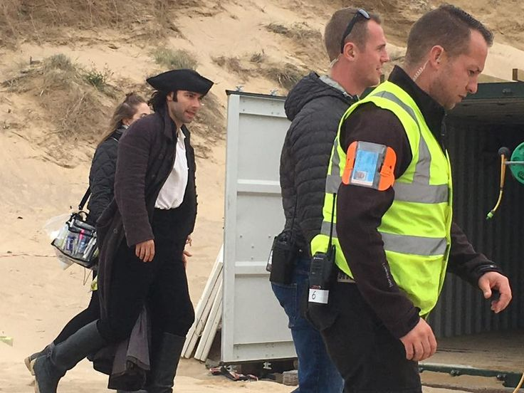 A very handsome Captain Ross Poldark (Aidan Turner) snapped by us filming the upcoming 2018 series of BBC's Poldark on Holywell Bay Beach, near Newquay, Cornwall   image credit: Country View Cottages