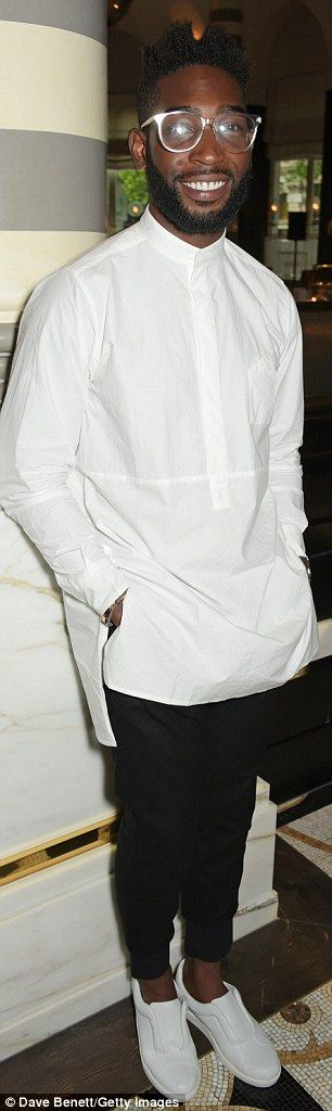 Tinie Tempah, who wore a contemporary white loose-fitting shirt, black trousers and white trainers.