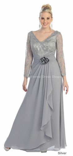 This elegant dress has long sheer sleeves with a lace pattern of them. The neckline is a V shape along with the back The bust is also the lace design. The waist has a wrap accented with a ruffled flow