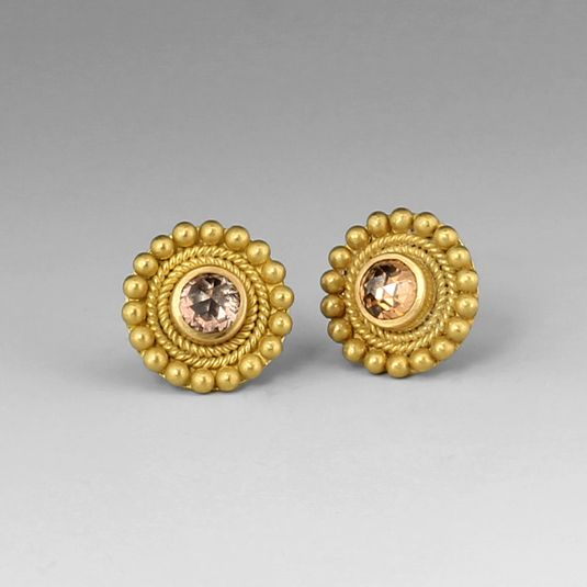 """These Reinstein/Ross earrings are not your average pair of diamond studs! The sweet and feminine rose cut pale pink diamonds are surrounded by hand braided 20k peach gold, with an outer edge of large granules. The style, aptly named """"Grecian Studs,"""" is truly a timeless treasure! @quadrum"""