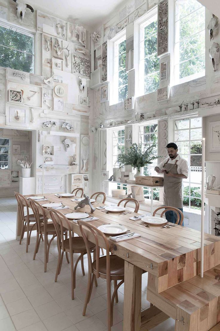 Hueso Restaurant in Mexico pale bentwood seating / white walls