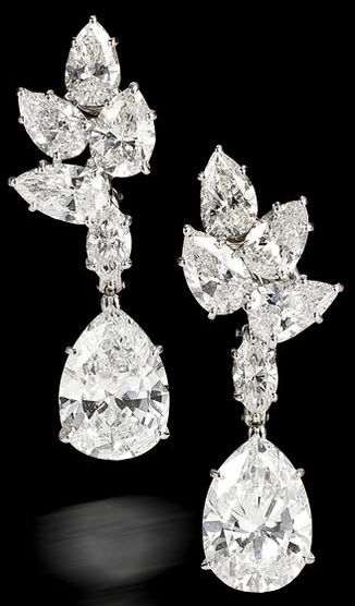 pair of diamond pendant earrings, Harry Winston, 1967. each designed as a pear-shaped diamond, weighing 3.90 and 3.43 carats, suspended from a marquise-shaped diamond and a cluster surmount of pear-shaped diamonds; unsigned, no. 6439, with signed box; remaining diamonds weighing approximately: 5.50 carats total.✿⊱╮