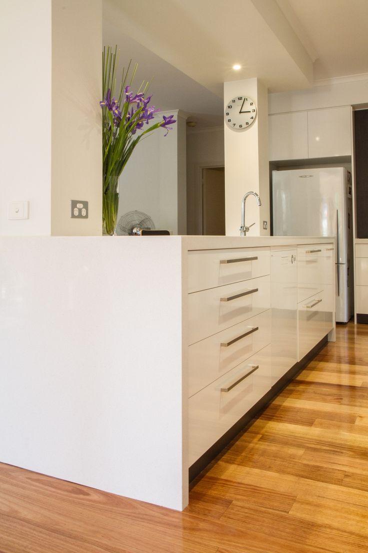 White modern kitchen. Waterfall end bench. www.thekitchendesigncentre.com.au