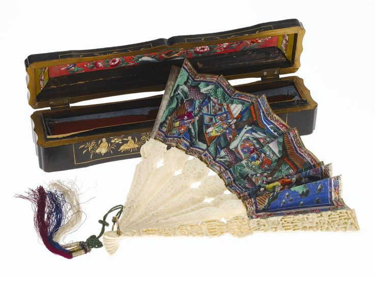 Folding fan with carved ivory guards and sticks, and paper mount painted with figures with applied ivory faces and some applied woven silk garments. China, 19th century.