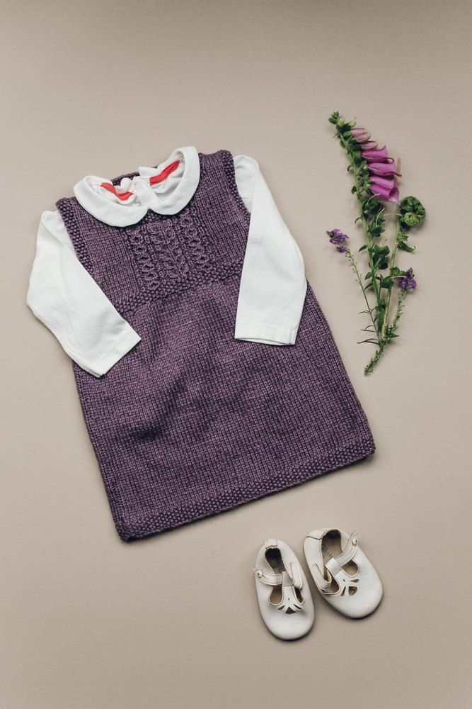 Girls dress with simple cable detailing. Find the pattern for this beautiful purple baby dress at LoveKnitting.Com.