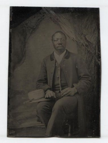 TINTYPE-AFRICAN-AMERICAN-MAN-HOLDING-STRAW-HAT-SEATED-TINTED-CHEEKS
