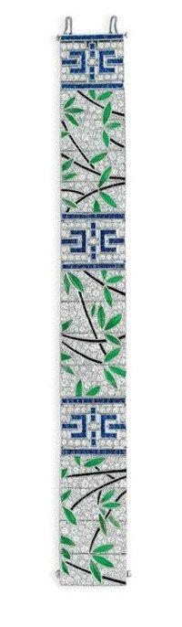 An antique Art Deco diamond, sapphire, jade, and onyx bracelet. Circa 1925. Via Diamonds in the Library.