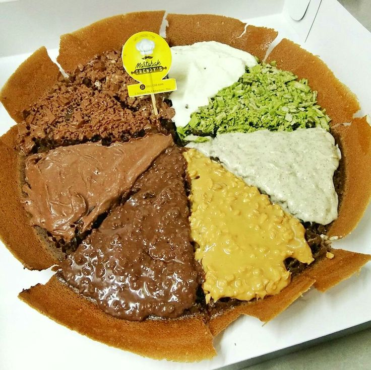 Sweet temptation.. Pancake from indonesia.. Its call MARTABAK.. With 8 topping.. Ovomaltine, skippy, toblerone, kitkat greentea, creamcheese, 2more i forgot..